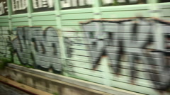 Tracking shot of Italian town graffiti and buildings Stock Footage