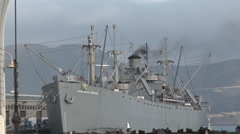 Pier 43 Ferry Arch with Jeremiah O'Brien warship at Pier 45 in Fisherman Wharf Stock Footage