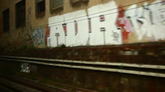 Italian town graffiti and houses from a train window Stock Footage