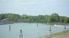 Passing shot of water and nearby italian town. Stock Footage