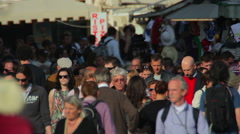 Shot of locals and tourists walking and shopping in Venice. Stock Footage
