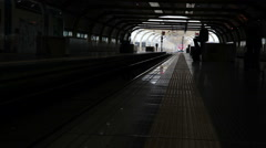 Train arriving in a dim tunnel in Italy Stock Footage
