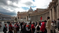 A tour group enters the colonnade surrounding St Peter's Square in Vatican City. Stock Footage