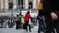 Tourists walking around and posing for pictures in St Peter's Basilica and Stock Footage