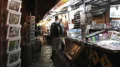 Souvenir stalls at night Stock Footage