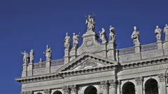Statues atop facade of St. John Lateran's Archbasilica Stock Footage