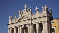 Close up of statues atop the Archbasilica of St John Lateran Stock Footage