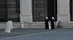 Two nuns cross Piazza San Giovanni Stock Footage