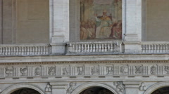 Painting on exterior wall of building surrounding Piazza San Giovanni Stock Footage