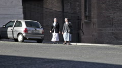 Two nuns crossing a street Stock Footage