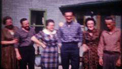 2361 - family & friends pose together for photos - vintage film home movie Stock Footage
