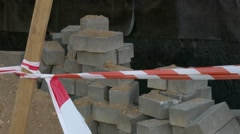 Ungraded: Red-White Barrier Tape Protects Construction Site Stock Footage