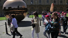 A group of children walk by the Sphere Within Sphere in Vatican City. - stock footage