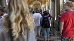 Tourists walk down a marble hallway. Stock Footage