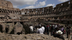 Tourists looking around inside the Colosseum - stock footage