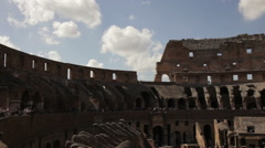 The Colosseum seen from the inside with tourists walking around. - stock footage
