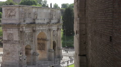 The Arch of Constantine stands aside the Colosseum Stock Footage