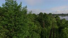 Beautiful Crane shot of tree and train tracks. Stock Footage