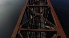 Amazing Low aerial shot over old rusty metal train bridge. Stock Footage