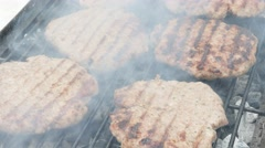 Meat on bbq slow smoked with fire from charcoal 4K 3840X2160 UltraHD footage Stock Footage