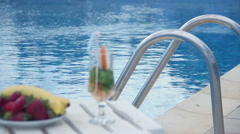Fruit cocktail at poolside, all inclusive service, summer resort - stock footage