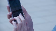 Close-up of female hands typing text, message on touchscreen Stock Footage