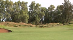 Green Set in LOw Lying Dunes - Classic Links Golf Course Stock Footage