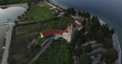 Aerial scene of peninsula composed of parks and church, monastery. Stock Footage