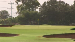 Traditional Golf Course Design Prevails Over Urban Encroachment Stock Footage