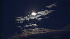 clouds moving around bright moon - stock footage