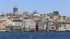 Architecture, ship and Galata tower the Golden Horn bay in Istanbul, Turkey Stock Footage