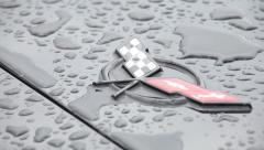 Corvette logo after rain - stock footage