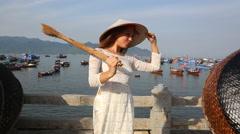 blonde girl in vietnamese has nice time in fishing village - stock footage