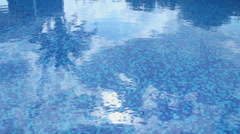 Swimming pool blue water surface. Summer vacation, resort, hotel Stock Footage