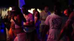 Group of people dancing in Punta Cana at night Stock Footage