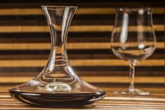 decanter and glass with wine on wooden background - stock photo