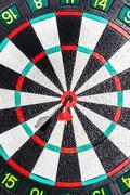 Darts arrows in the target center Stock Photos