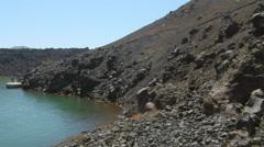 Stock Video Footage of Volcanic Island near  Santorini, Greece.