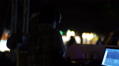 Two DJs waving hands at a night beach party in Punta Cana Stock Footage