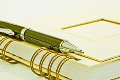 Notepad and ball pen - stock photo