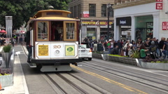 Passengers riding on cable car in San Francisco, California Stock Footage