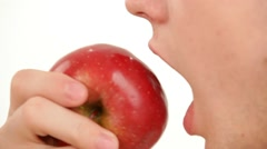 Man eating a red apple profile is insulated on white Stock Footage