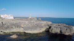 Cliffs & historic Lighthouse - Aerial Flight Stock Footage