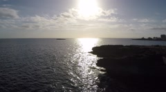 Sunset on a Ocean Cliff - Aerial Flight Stock Footage
