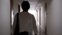 Man walking in apartment and open the door - stock footage