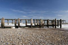 Pier and Sea Defences on Lowestoft Beach, Suffolk, England - stock photo