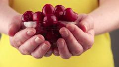 Woman Holding a Bowl with Ripe Sweet Cherries Stock Footage