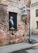 Kaunas, Lithuania - July 12, 2015: Drawing of naked little boy urinating pain Stock Photos