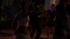 Two girls dancing on the beach in Punta Cana at night Stock Footage