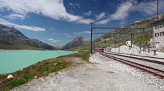 On the railway station in Alpine landscape, Ospizio Bernina, Switzerland Stock Footage